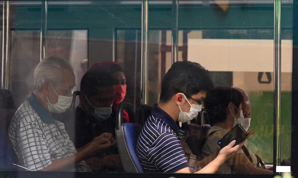 People wearing protective face masks on a public bus in Singapore on Tuesday.