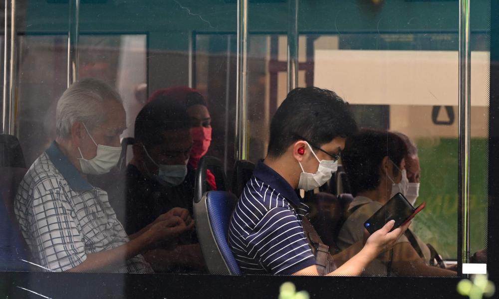 Bus passengers in face masks in Singapore