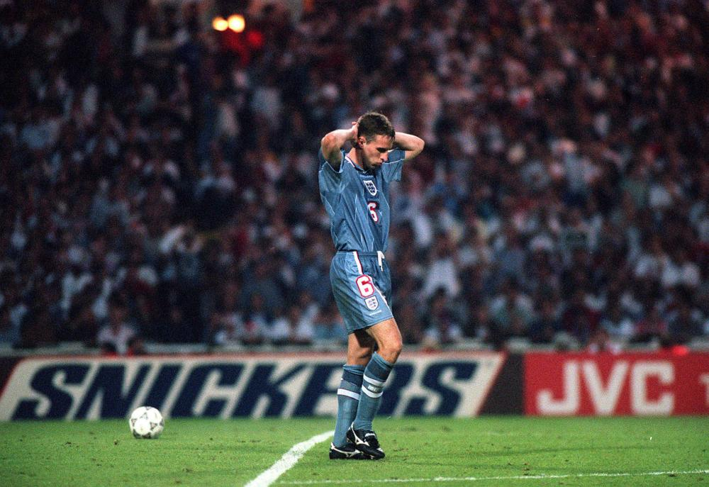 Gareth Southgate dejected after failing to score in the penalty shoot out.