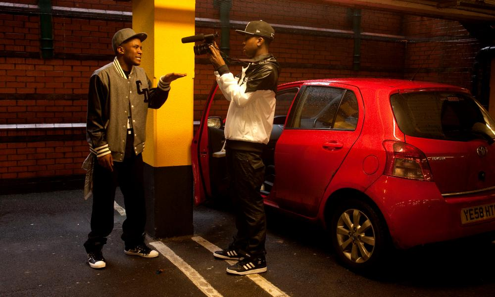 YouTube hero: Jamal, above, filming a west London MC in a supermarket car park.