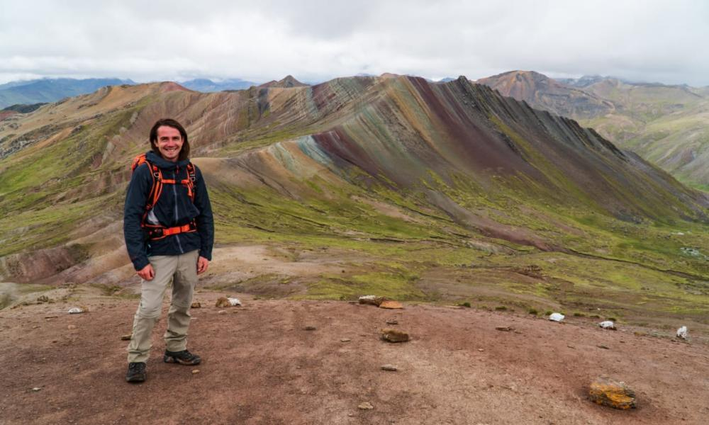 Chris Ramsay in happier times trekking at the Vinicunca Rainbow Mountain in Cusco.