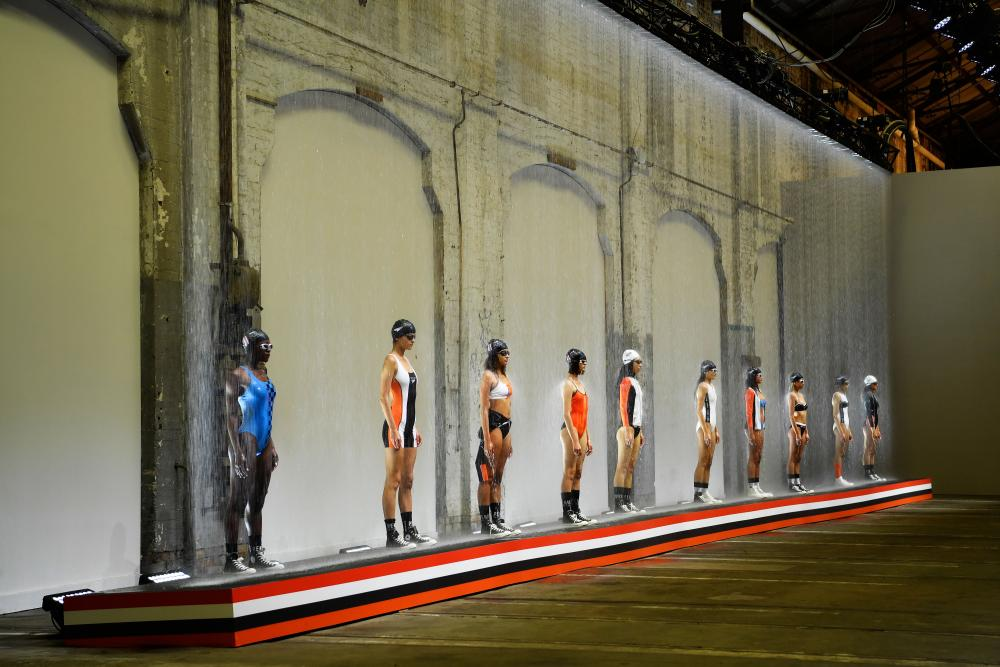 Models walk the runway during the P.E Nation show at Mercedes-Benz Fashion Week Resort 20 Collections at Carriageworks.