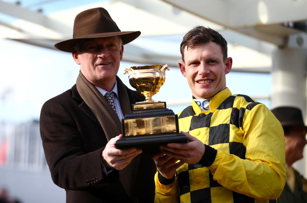 Jockey Paul Townend (right) and trainer Willie Mullins hold the trophy after winning the Gold Cup Chase with Al Boum.