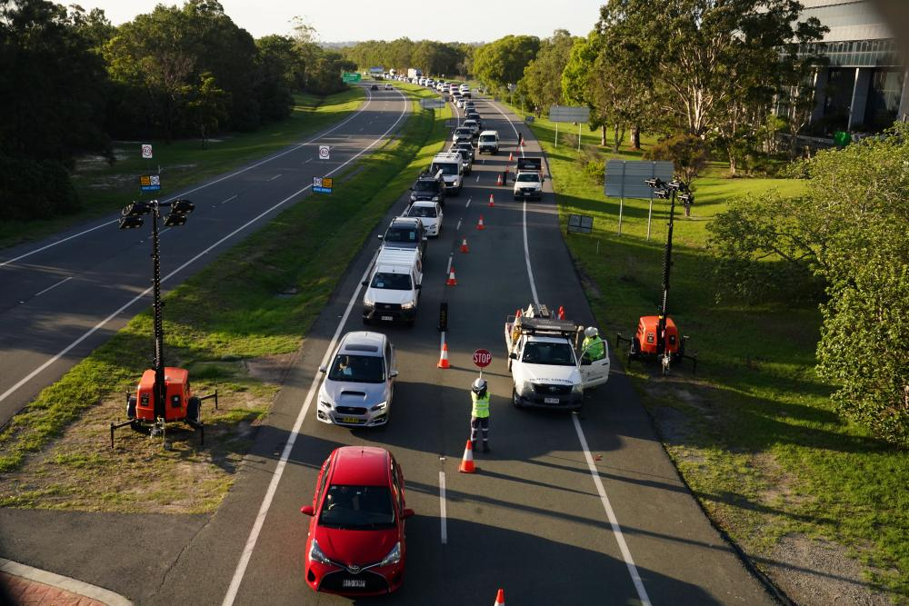 Motorists approaching the Queensland / NSW border checkpoint in Coolangatta in late December.