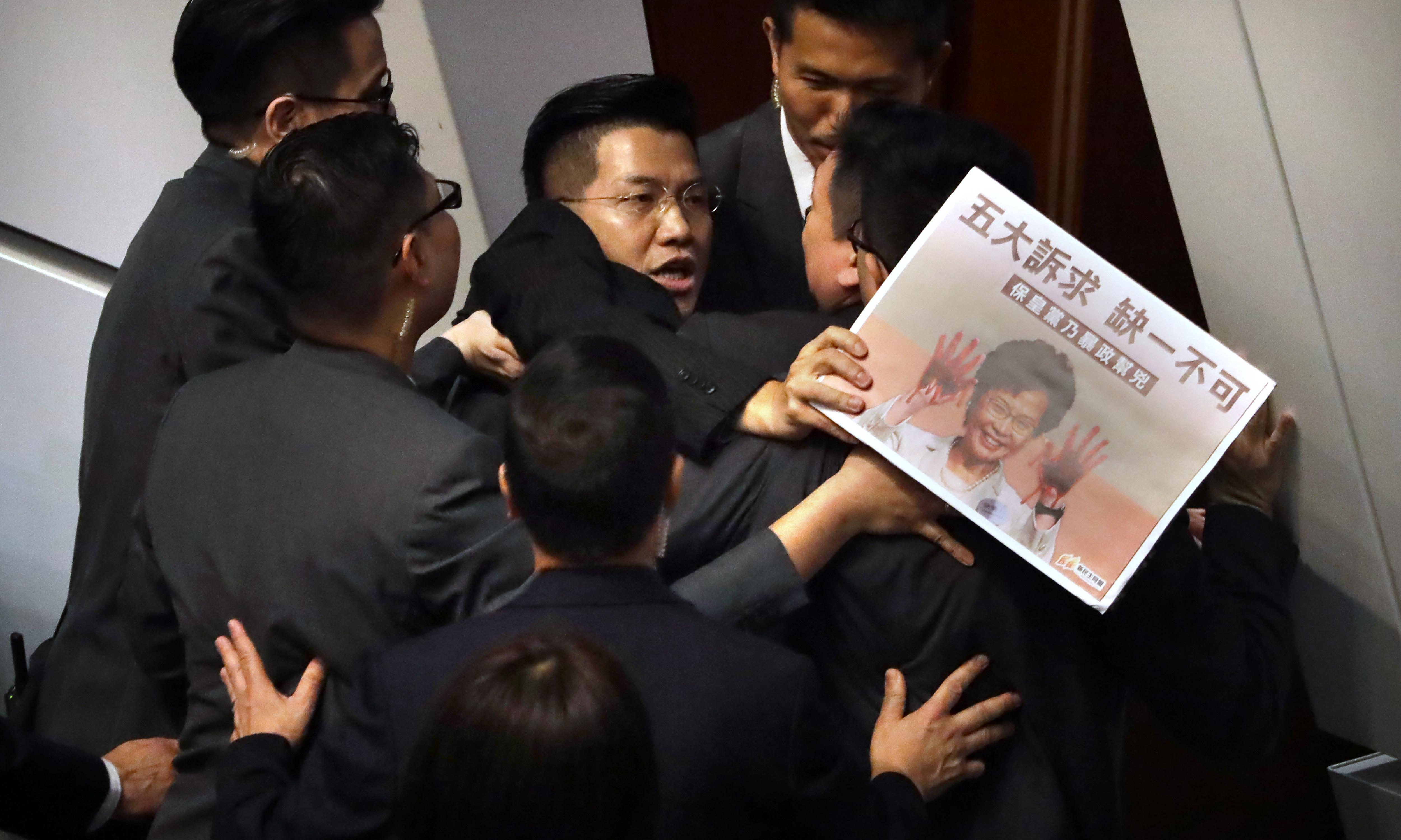 Chaos in Hong Kong chamber over violent attack on activist