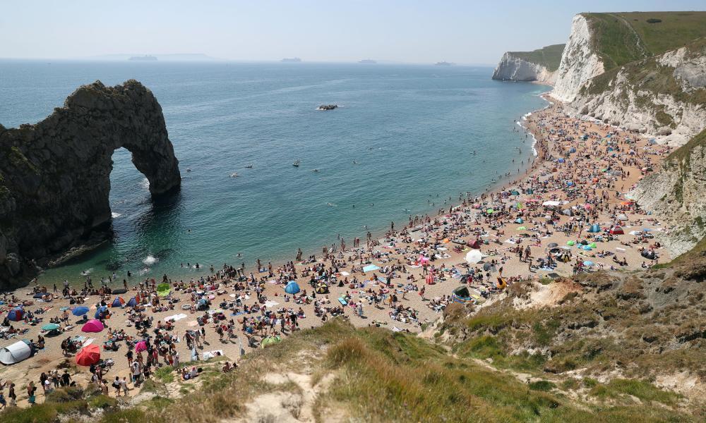 People on the beach at Durdle Door, near Lulworth in Dorset on Saturday.