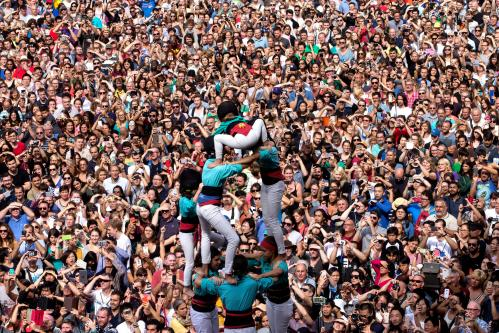 Castellers build a human tower during La Mercè festival at Plaça Sant Jaume in Barcelona