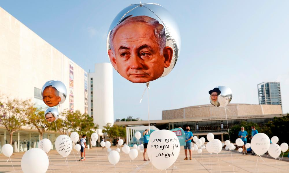 Balloons installed, on September 15, 2020 in Habima Square in the Israeli city of Tel Aviv to symbolise promises made by Israeli Prime Minister Benjamin Netanyahu that he failed to keep.