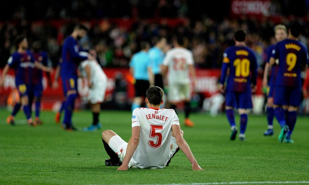 Sevilla's French defender Clement Lenglet sits on the field at the end of the match.