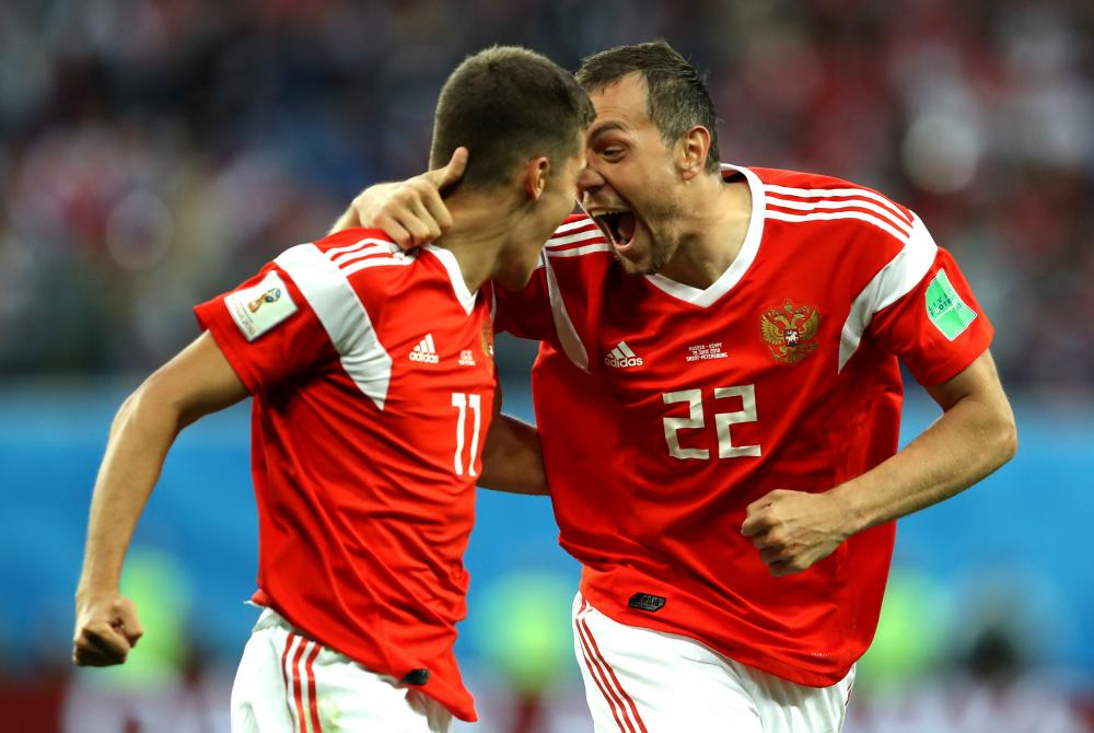 Artem Dzyuba and Roman Zobnin of Russia celebrate the goal.