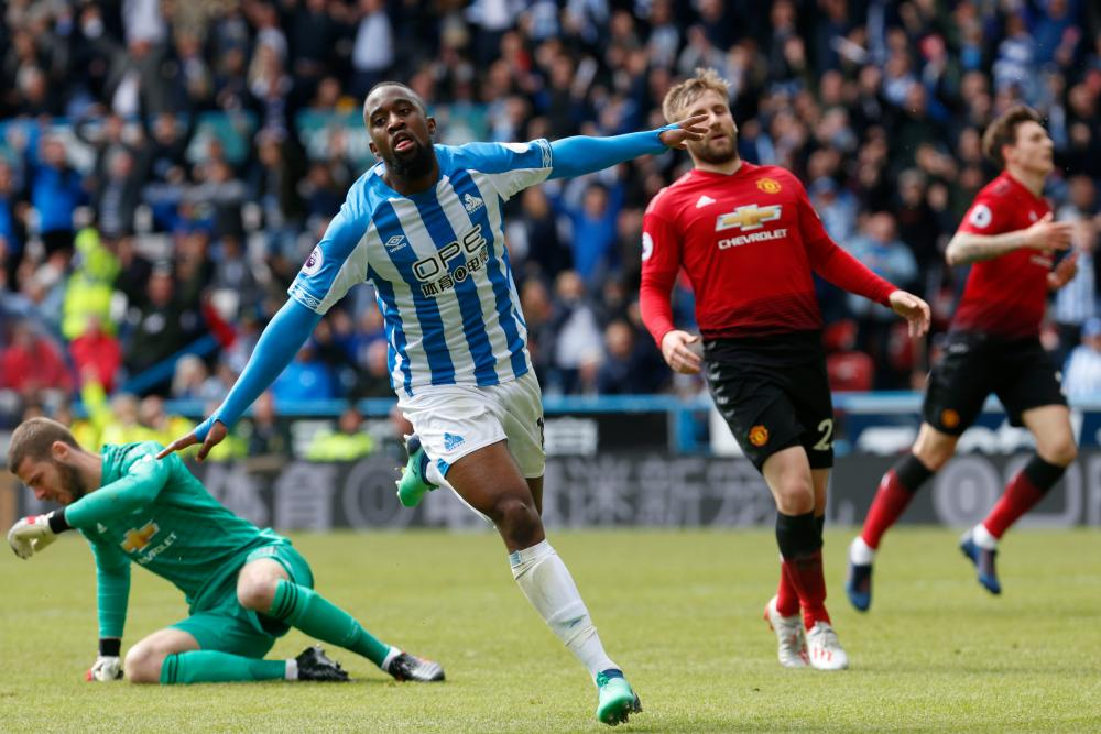 May 5: Isaac Mbenza of Huddersfield celebrates his goal against Manchester United at John Smith's Stadium.