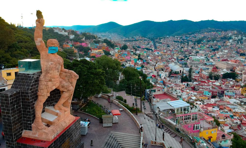 General view of the monument to the Pipila, which is adorned with a giant mask to raise awareness of the importance of their use during the coronavirus pandemic, in Guanajuato, Mexico, 2 September 2020.