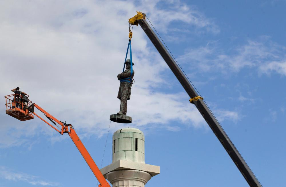 A statue of Robert E Lee is removed from Lee Circle in May 2017 in New Orleans.