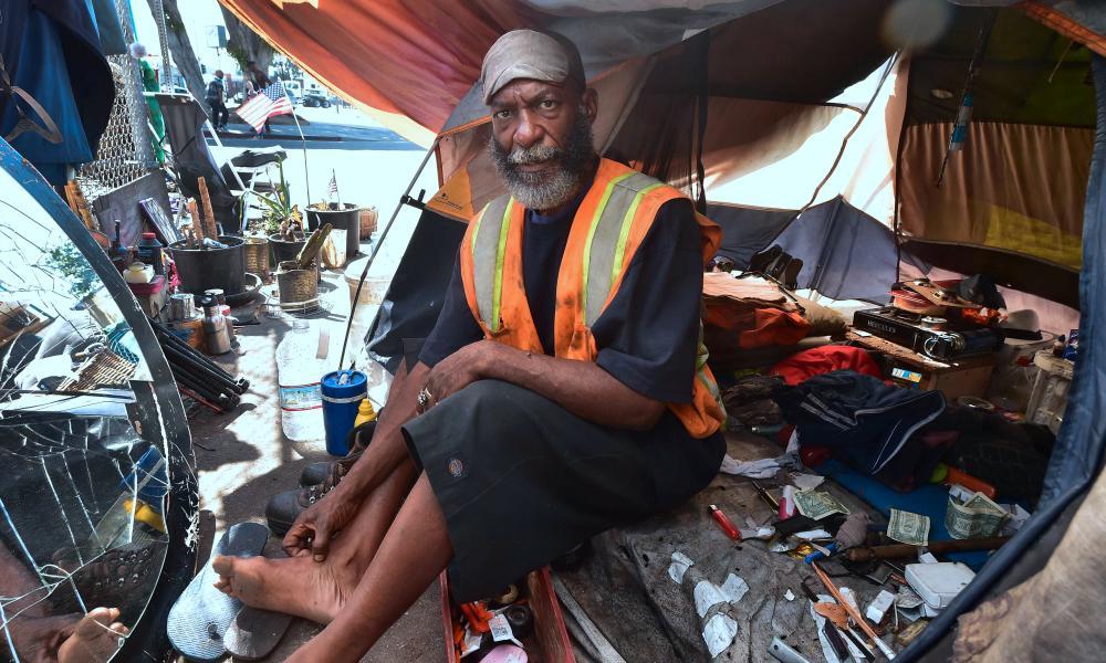 Homeless veteran Kendrick Bailey keeps cool inside his tent on a street corner near Skid Row, in downtown Los Angeles.