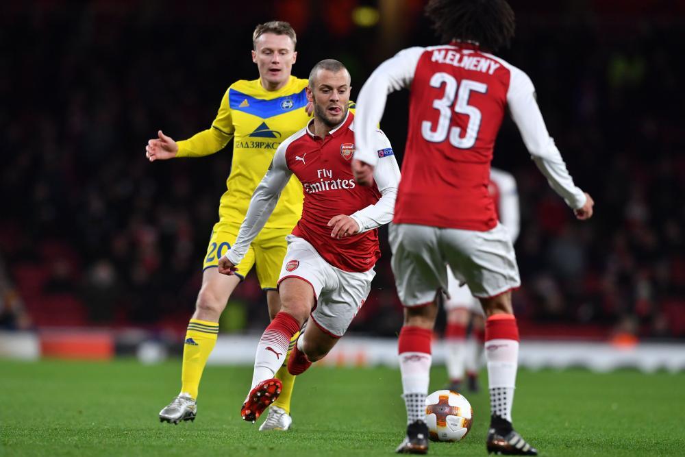 Arsenal's Jack Wilshere surges past Bate Borisov's Vitale Rodionov.