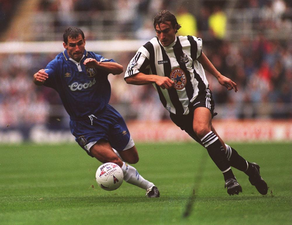 David Ginola skips own the wing for Newcastle United.