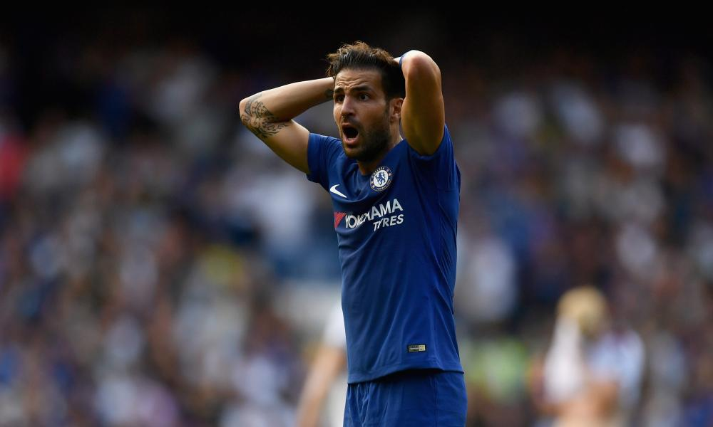 Cesc Fabregas in disbelief at being sent off.