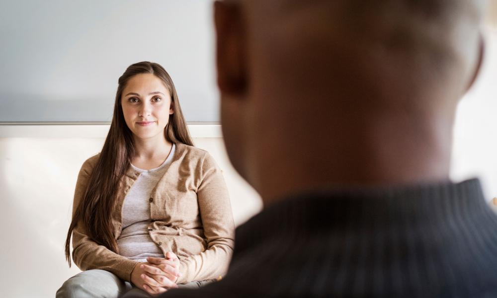therapist listening to her client
