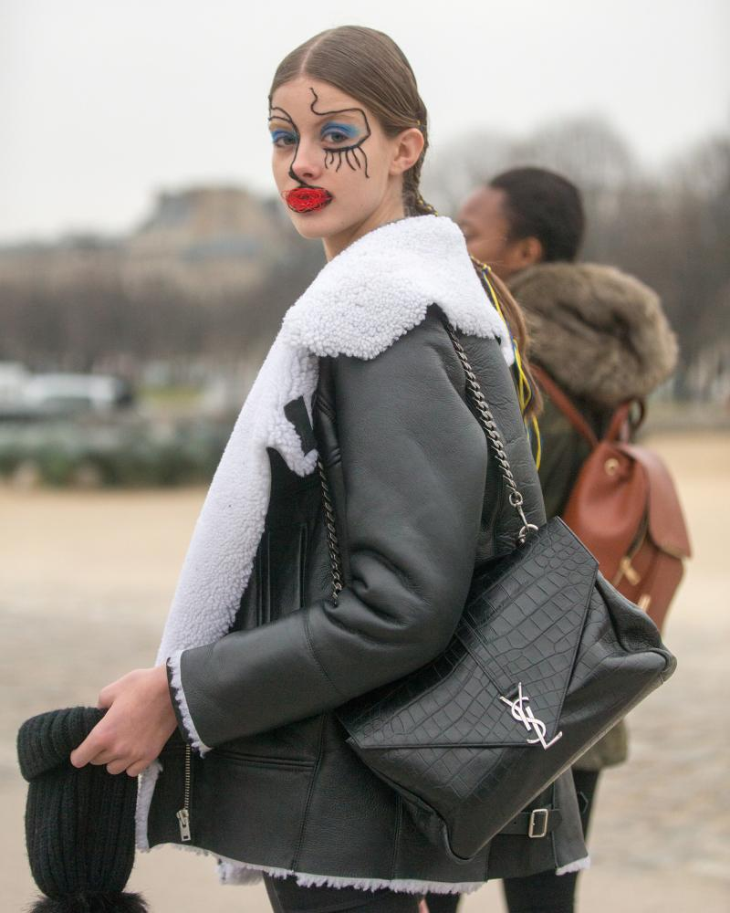 Street Style : Day Four - Paris Fashion Week- Haute Couture Spring Summer 2017PARIS, FRANCE - JANUARY 25: Bara Podzimkova wears a shearling bomber jacket and a YSL purse and wears makeup by Pat McGrath and hair by Eugene Souleiman after the Maison Margiela show on January 25, 2017 in Paris, France. (Photo by Melodie Jeng/Getty Images)