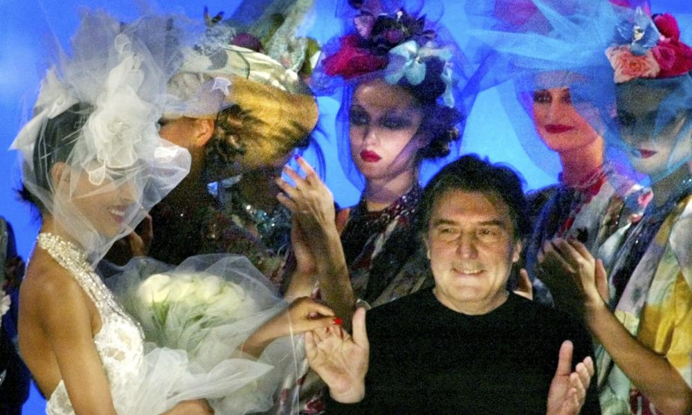 Emanuel Ungaro acknowledging applause at the end of his spring summer haute couture 2003 fashion collection presented in Paris.
