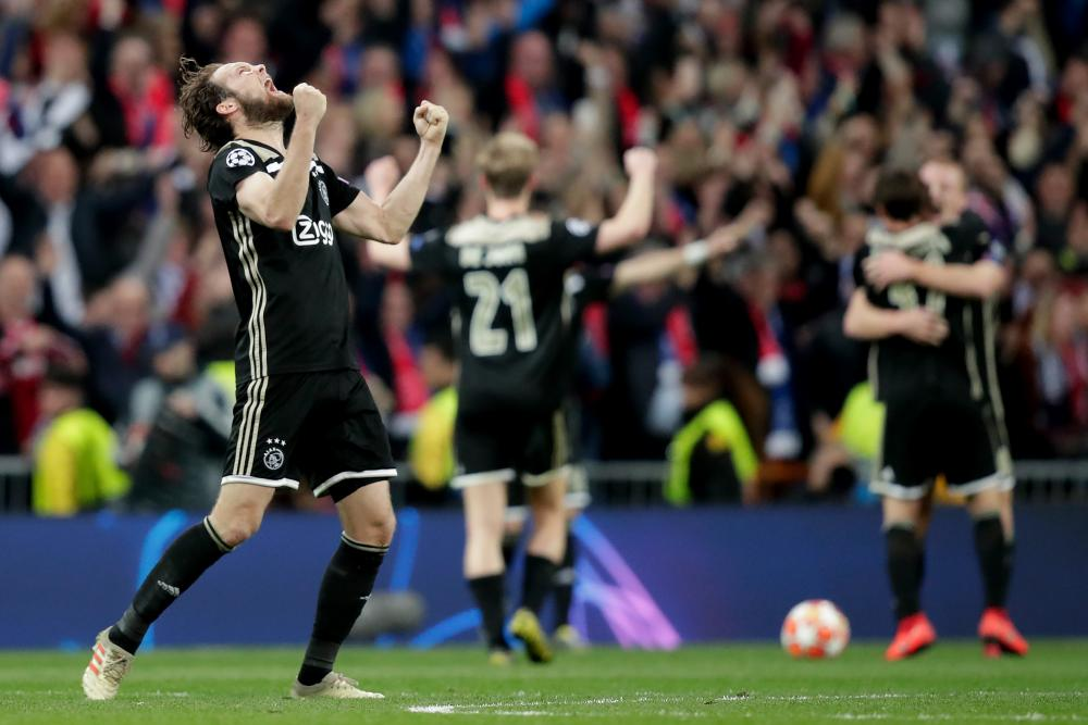 The final whistle goes and Daley Blind and his Ajax teammates celebrate a famous victory.