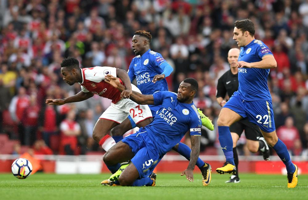Danny Welbeck is stopped by Wes Morgan.