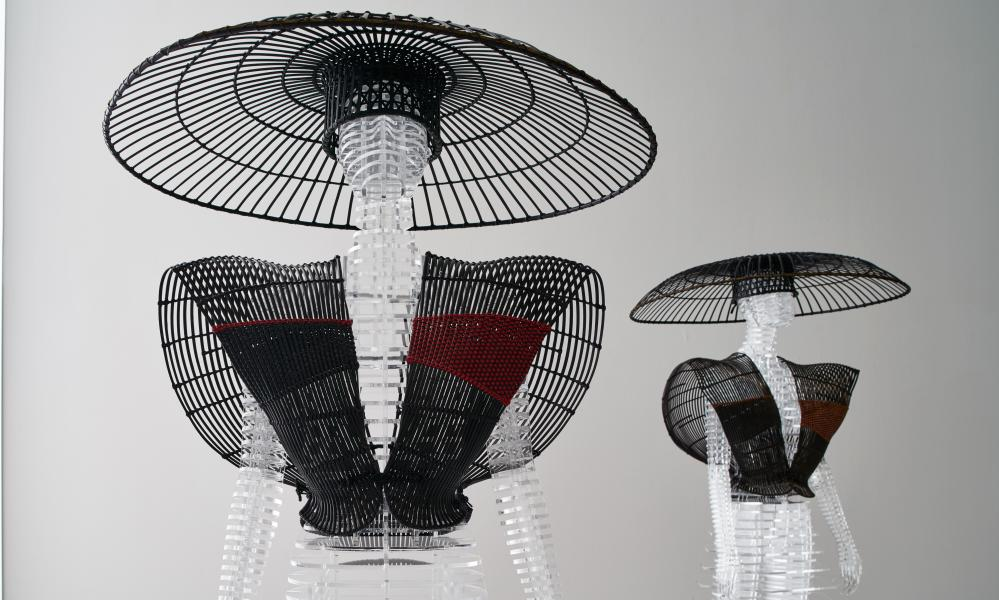 Hat stand: a 'body' made from rattan and bamboo using traditional techniques for the shows in 1981.