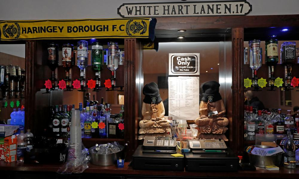 A White Hart Lane road sign mounted on the wall behind the bar at Coles Park Stadium.