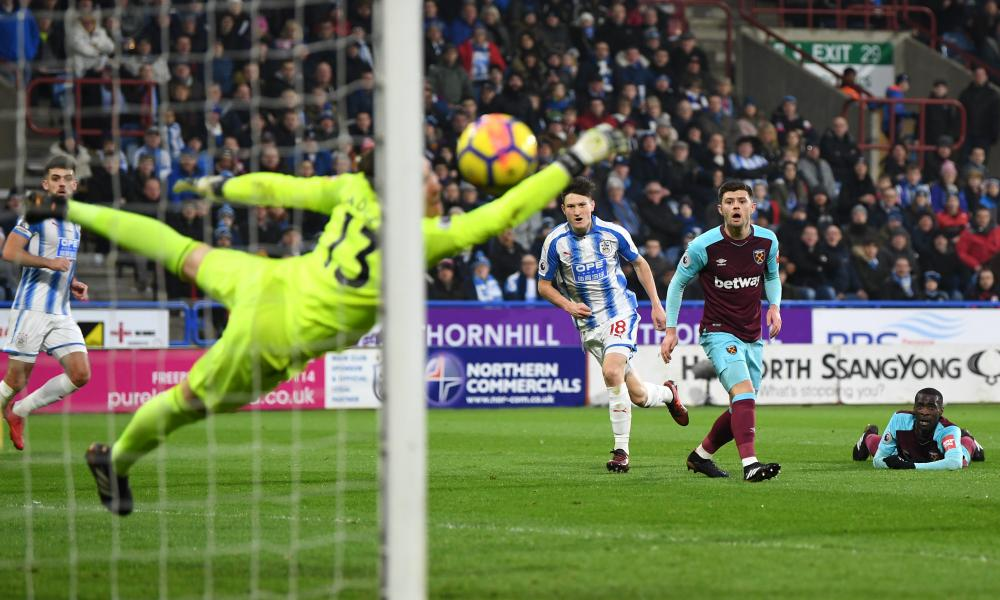 Joe Lolley of Huddersfield Town watches his shot fly into the net and get the Terriers back in the game.
