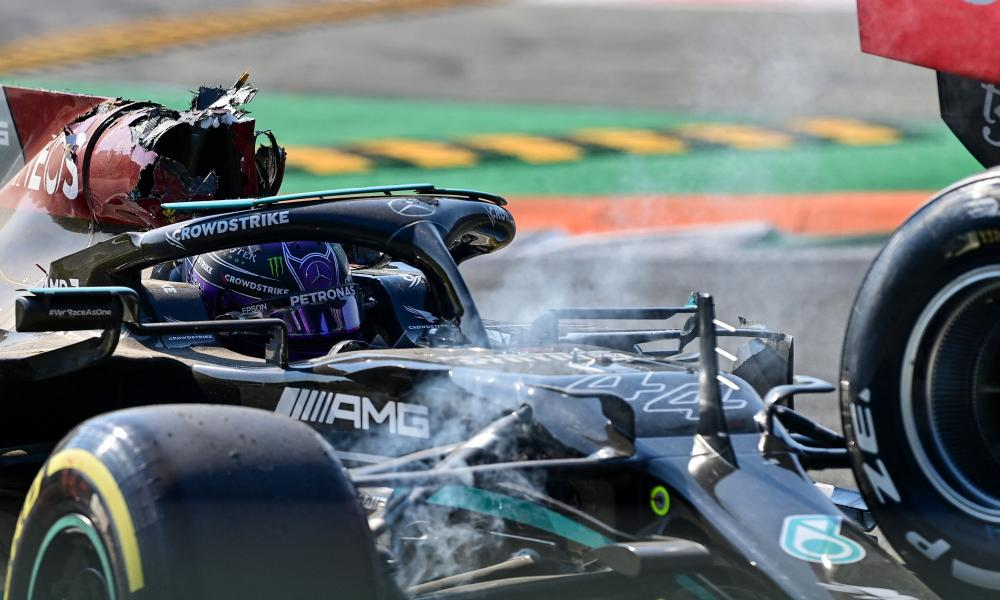 Lewis Hamilton reacts in his car following a collision