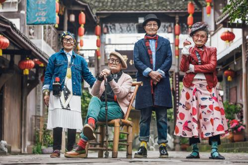 A group of fashionable nonagenarians pose for a photo in Pengzhou