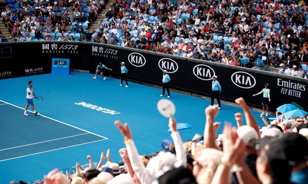 Fans celebrate a point at Melbourne ParkPhoto: REUTERS/Edgar Su