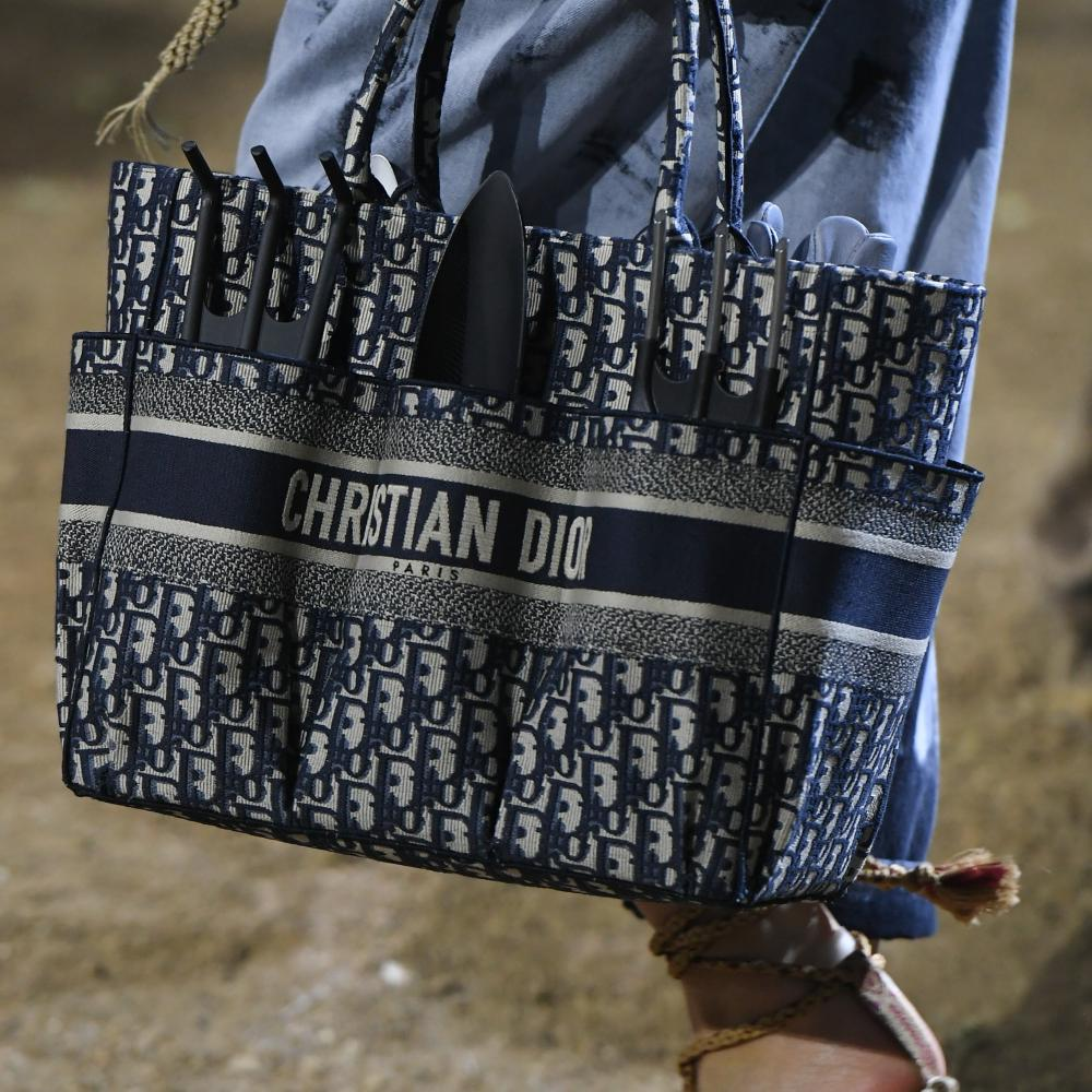 The hit embroidered 'book tote' bag was featured in the show with garden forks and trowels.