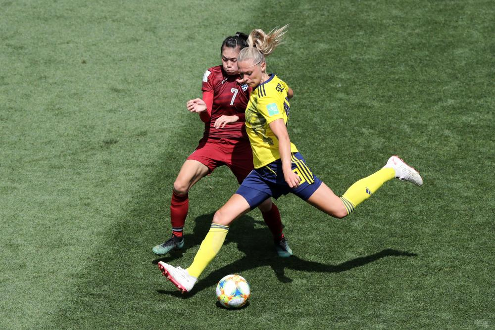 Fridolina Rolfo of Sweden scores her team's third goal.