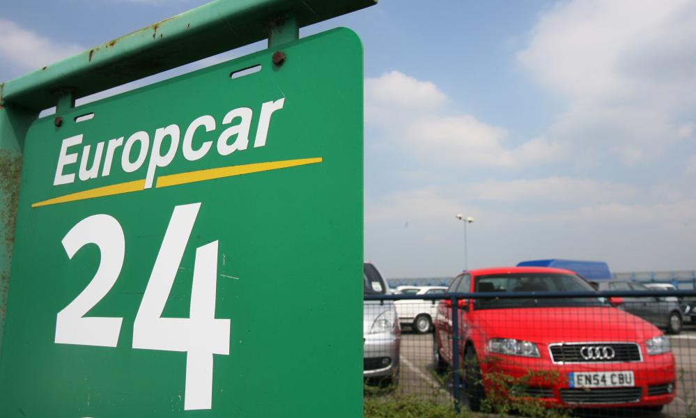 Cars parked in a Europcar rental lot at London City Airport