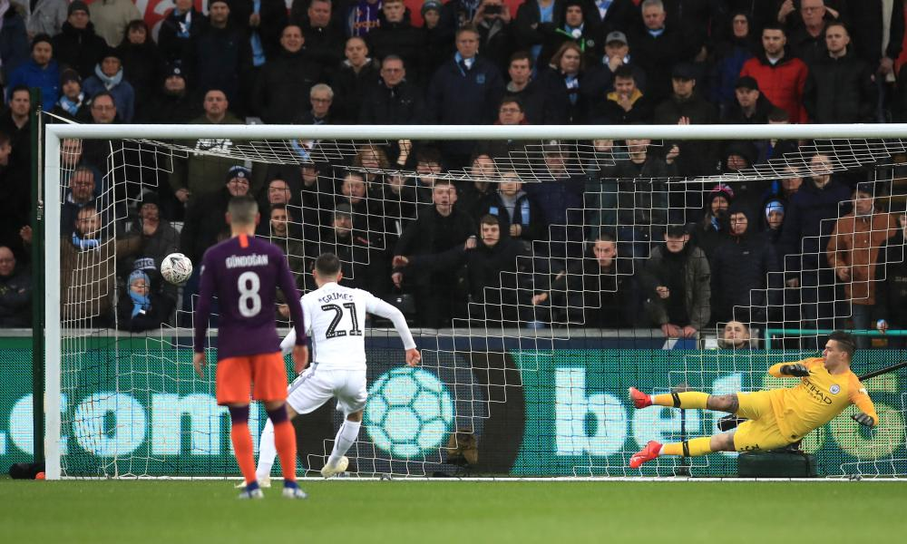 Matt Grimes of Swansea City scores his team's first goal from the penalty spot.