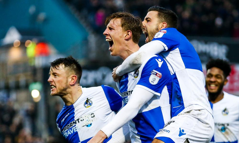 Joe Partington celebrates with teammates Ollie Clarke and Liam Sercombe after scoring of Bristol Rovers' equaliser against Bradford.