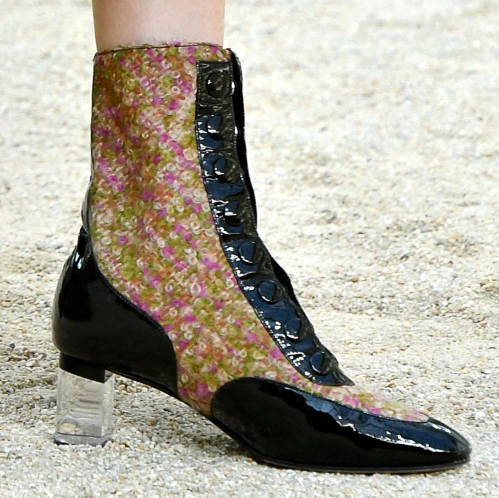 Ankle boots covered with tweed with a perspex-block heel.