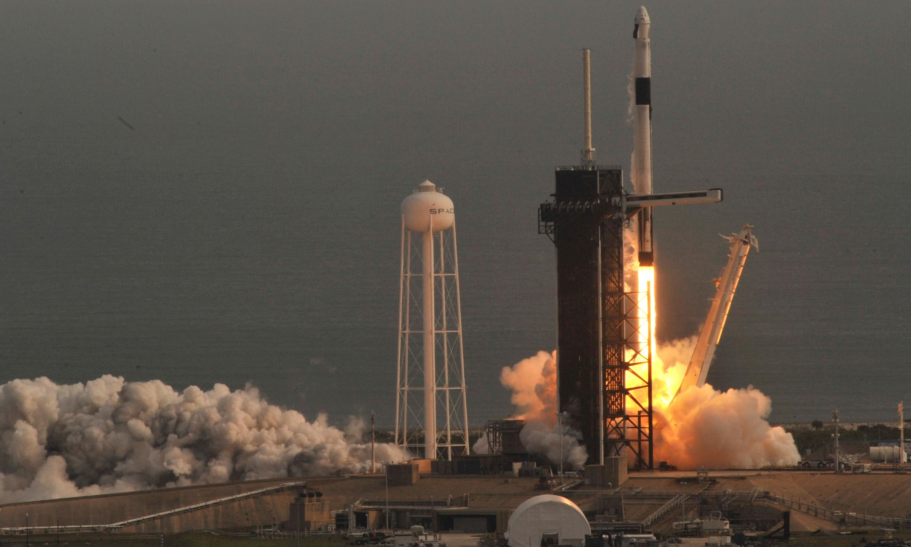 SpaceX crew capsule escape test a success as crowds watch rocket explode