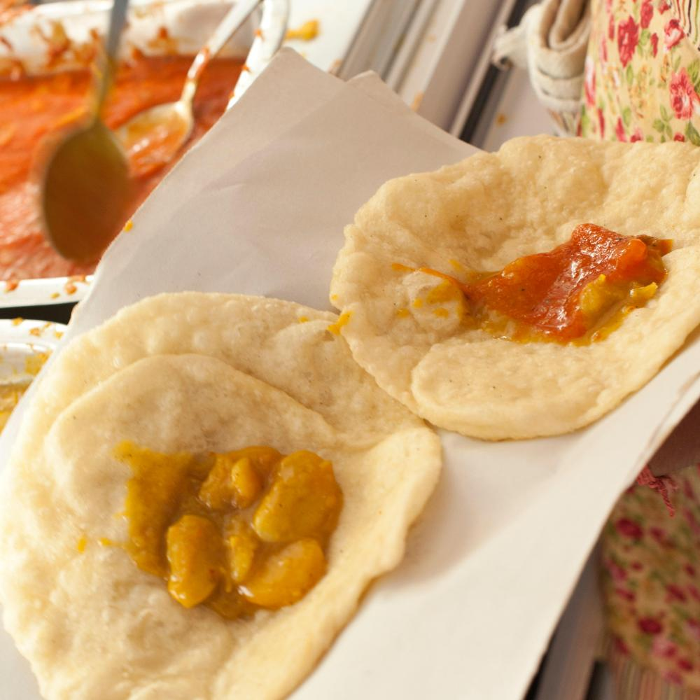 The puri are filled with a dribbly but delicious butter bean curry.