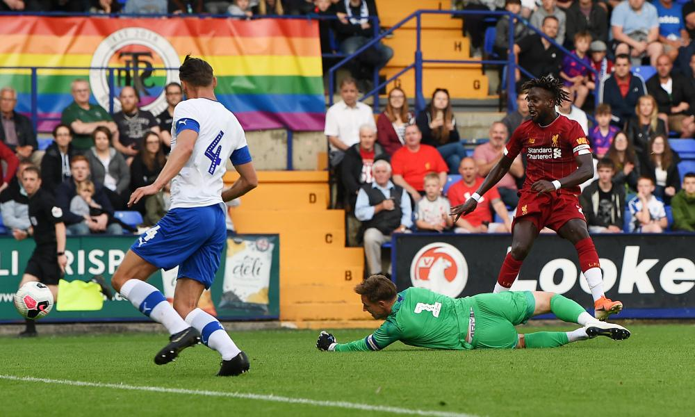 Divock Origi scores Liverpool's fifth goal of the night at Prenton Park.