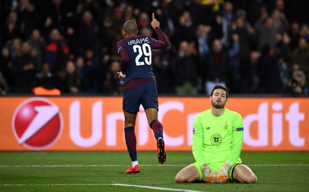 Kylian Mbappe celebrates scoring his team's fourth goal.