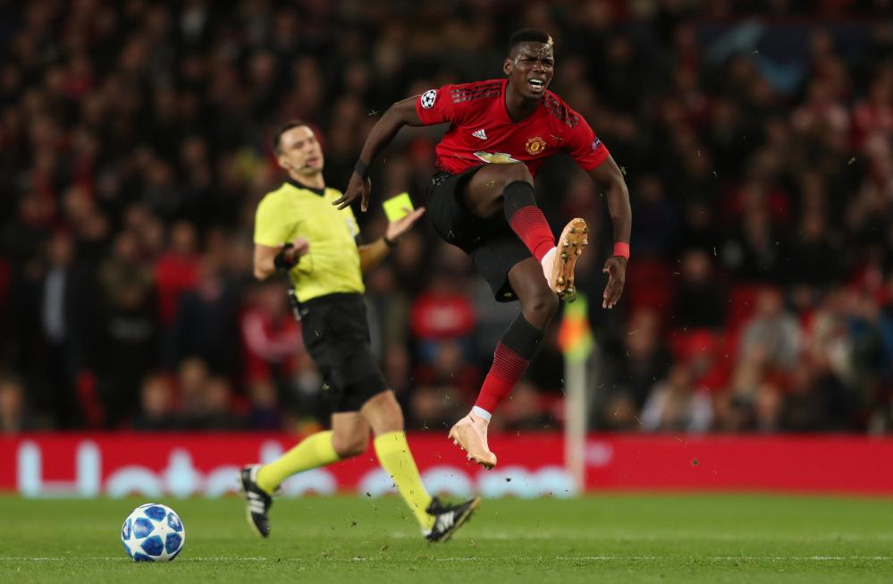 Paul Pogba is frustrated when referee Slavko Vincic doesn't allow play to carry on.