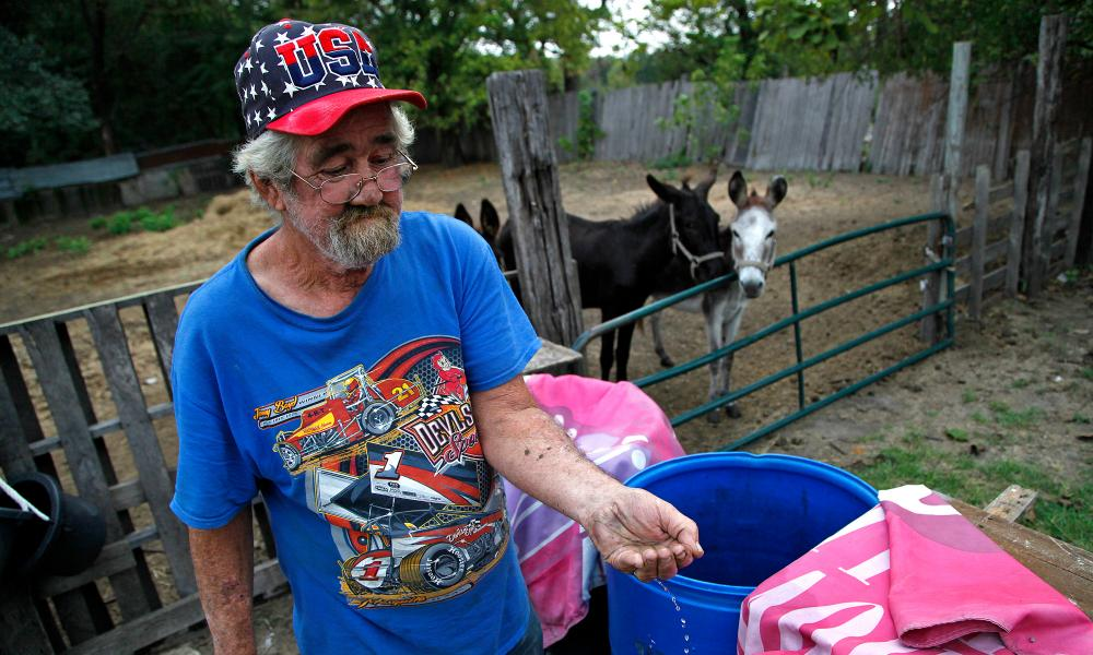 Richard Shivers, 59, a resident of Sandbranch, Texas, drinks the well water he collects in plastic barrels on his lot in the community on Saturday, October 7, 2017 (Stewart F. House/Special Contributor)