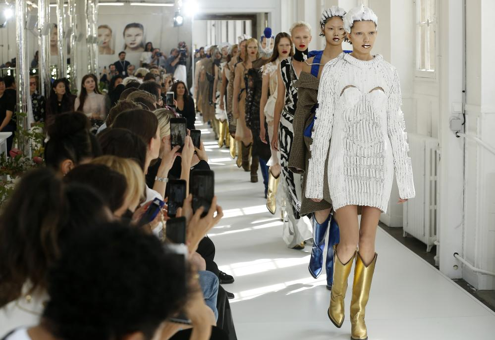 Models on the Maison Margiela couture catwalk.