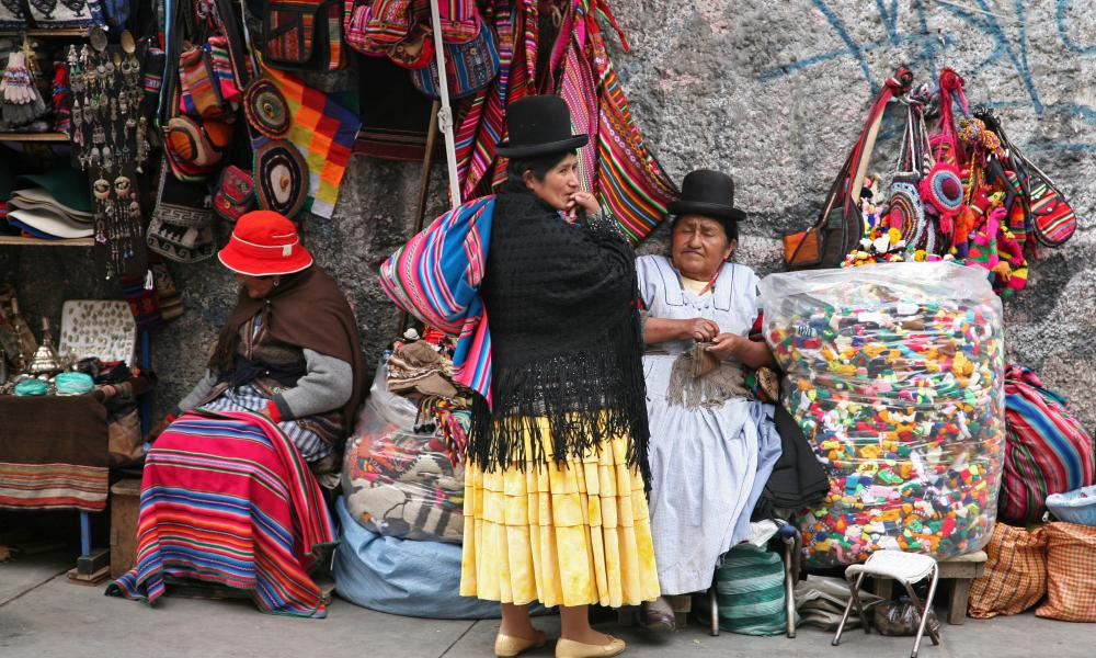 Old women with traditional hats at market stall