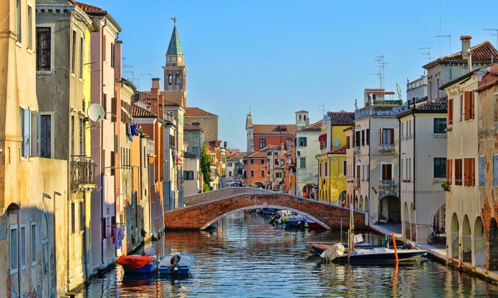 Great water view of Chioggia with vintage cabins and bridgeChioggia, little Venice in Italy