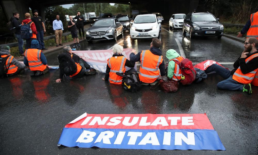 Insulate Britain activists blocking a motorway junction near Heathrow last week