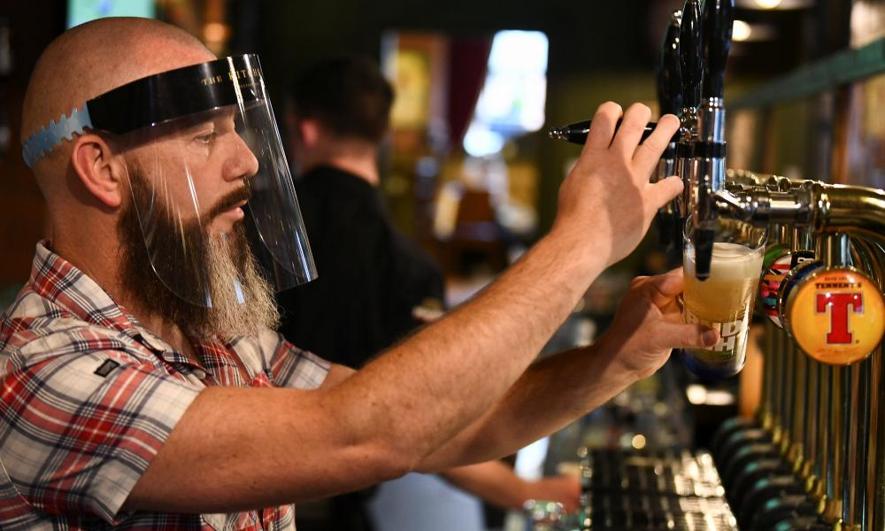 A bartender pours beer at The Kitchen Bar in Belfast, Northern Ireland.