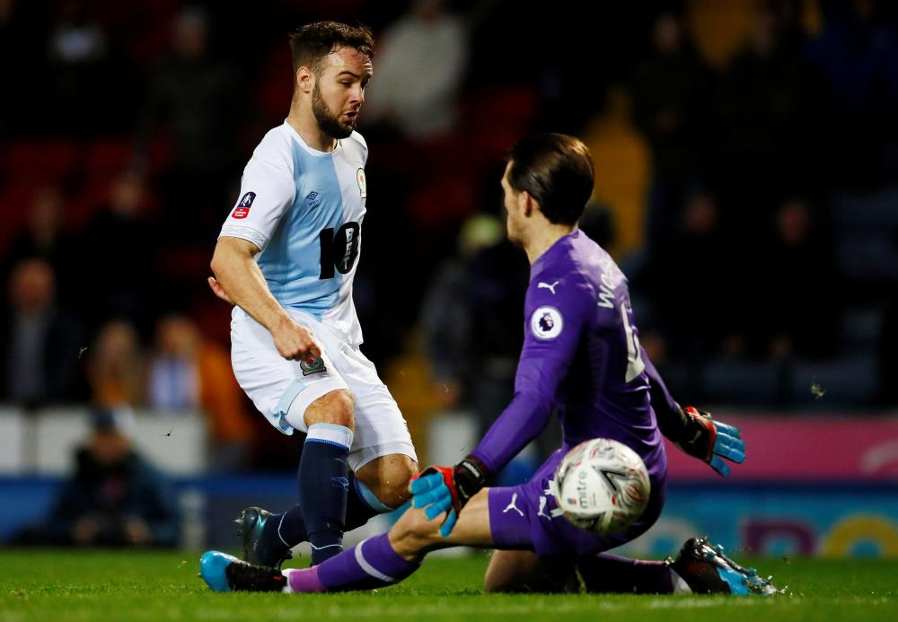 Adam Armstrong slots the ball past Woodman.